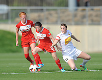 Boyds MD - April 13, 2014: Diana Matheson (8) of the Washington Spirit goes against Adriana Martin (11) of the Western New York Flash. The Western New York Flash defeated the Washington Spirit 3-1 in the opening game of the 2014 season of the National Women's Soccer League at the Maryland SoccerPlex.