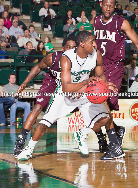 North Texas Mean Green guard Alzee Williams (3) in action during the game between the Louisiana Monroe Warhawks and the University of North Texas Mean Green at the North Texas Coliseum,the Super Pit, in Denton, Texas. UNT defeats ULM 86 to 51...
