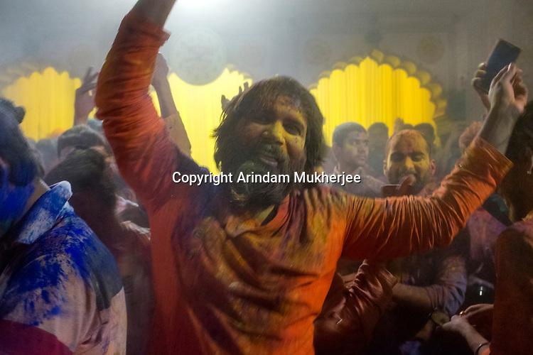 A devotee dances at Radha Ravan temple during Hoi Festival at Vrindavan. Holi - The  Hindu festival of colour is celibrated for a week in the Brraj region of Uttar Pradesh, India.