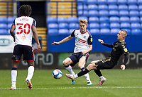 Bolton Wanderers' Harry Brockbank competing with Oldham Athletic's Jordan Barnett (right) <br /> <br /> Photographer Andrew Kearns/CameraSport<br /> <br /> The EFL Sky Bet League Two - Bolton Wanderers v Oldham Athletic - Saturday 17th October 2020 - University of Bolton Stadium - Bolton<br /> <br /> World Copyright © 2020 CameraSport. All rights reserved. 43 Linden Ave. Countesthorpe. Leicester. England. LE8 5PG - Tel: +44 (0) 116 277 4147 - admin@camerasport.com - www.camerasport.com