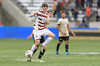 Houston, TX - Friday December 11, 2016: Foster Langsdorf (2) of the Stanford Cardinal blocks Ian Harkes (16) of the Wake Forest Demon Deacons from the ball at the NCAA Men's Soccer Finals at BBVA Compass Stadium in Houston Texas.