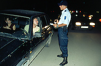 Kosovo. Pristina. Kosovo Police Service (KPS) has stopped a vehicle at a check point on the road. The police controls identities and looks for illegal weapons and drugs ( soft and hard). © 2001 Didier Ruef