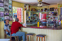 Barbados.  Customers in a Bathsheba Beachside Bar Serving Rum Punch Drinks and Refreshments.