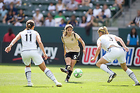 FC Gold Pride's Tina DeMartino splits LA Sol's defence of Brittney Bock (l) and Allison Faulk (r). The LA Sol defeated FC Gold Pride of the Bay Area 1-0 at Home Depot Center stadium in Carson, California on Sunday April 19, 2009.  .