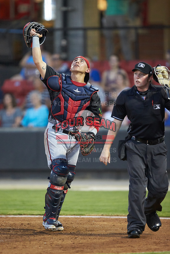 North Division catcher Tres Barrera (36) of the Potomac Nationals tracks a foul pop up as home plate umpire Austin Jones looks on during the 2018 Carolina League All-Star Classic at Five County Stadium on June 19, 2018 in Zebulon, North Carolina. The South All-Stars defeated the North All-Stars 7-6.  (Brian Westerholt/Four Seam Images)