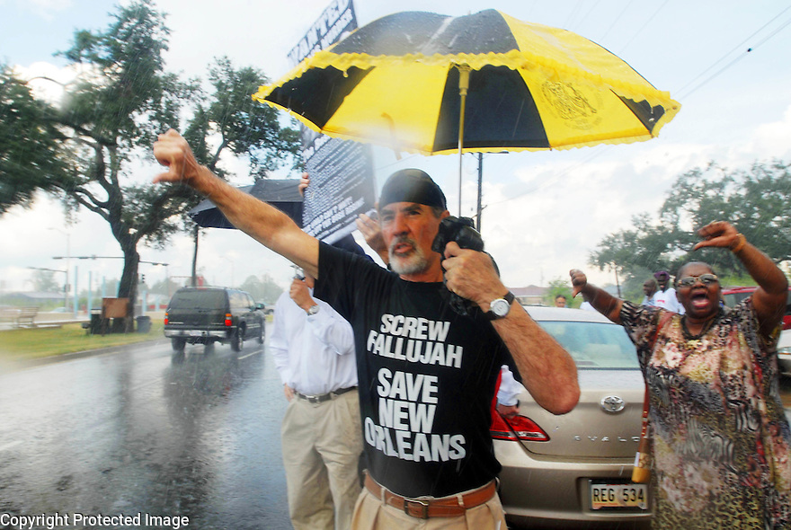 Jack Radosta protests President Bush's visit, despite the rain in the Lower Ninth Ward, 2007.