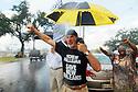 Jack Radosta protests President Bush's visit, despite the rain in the Lower Ninth Ward, 2007.
