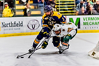 26 January 2019: Merrimack College Warrior Defenseman Matt McArdle, a Graduate student from Annapolis, MD, checks University of Vermont Catamount Matt Alvaro in first period action at Gutterson Fieldhouse in Burlington, Vermont. The Warriors fell to the Catamounts 4-3 in overtime after tying up the game in the dyeing seconds of the third period of their America East conference game. Mandatory Credit: Ed Wolfstein Photo *** RAW (NEF) Image File Available ***