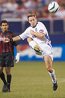 Richard Mulrooney of the Earthquakes wathched by Amado Guevara of the MetroStars. The San Jose Earthquakes and the the NY/NJ MetroStars played to a 4-4 tie on 7/02/03 at Giant's Stadium, NJ..