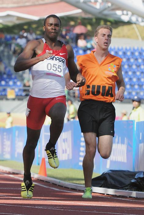 Brandon King, Guadalajara 2011 - Para Athletics // Para-athlétisme.<br /> Brandon King and guide race in the 100m T12 heats // Brandon King et guide dans les manches du 100m T12. 11/14/2011.