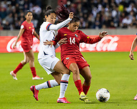 HOUSTON, TX - JANUARY 31: Christen Press #20 of the USA and Maryorie Perez #14 of Panama vie for the ball during a game between Panama and USWNT at BBVA Stadium on January 31, 2020 in Houston, Texas.