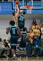 WASHINGTON, DC - FEBRUARY 8: Cyril Langevine #10 of Rhode Island blocks a shot from Chase Paar #3 of George Washington during a game between Rhode Island and George Washington at Charles E Smith Center on February 8, 2020 in Washington, DC.