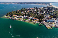 BNPS.co.uk (01202) 558833. <br /> Pic: TailorMade/BNPS<br /> <br /> Pictured: Harbour Gate on the exclusive Sandbanks peninsula. <br /> <br /> A multi-millionaire is hoping to have a shot at selling his luxury mansion - by throwing a hi-tech golf simulator into the deal.<br />  <br /> Golf-loving Barry Bester put the waterfront property on Sandbanks, Dorset, on the market for £11m last year.<br />  <br /> He is now offering his £40,000 state-of-the-art simulator he has had built on the grounds with the sale.