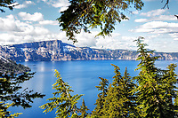 A view of Crater Lake during the early summer with snow still on the ground, Crater Lake National Park, OR.