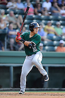 Catcher Eric Sim (11) of the Augusta GreenJackets bats in a game against the Greenville Drive on Friday, July 11, 2014, at Fluor Field at the West End in Greenville, South Carolina. Greenville won, 7-6. (Tom Priddy/Four Seam Images)