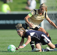Washington Freedom midfielder Sonia Bompastor (8) gets foul by FC. Gold Pride Leslie Osborne (10).  Washington Freedom defeated FC Gold Pride 3-1at the Maryland SoccerPlex, Sunday May 31, 2009.