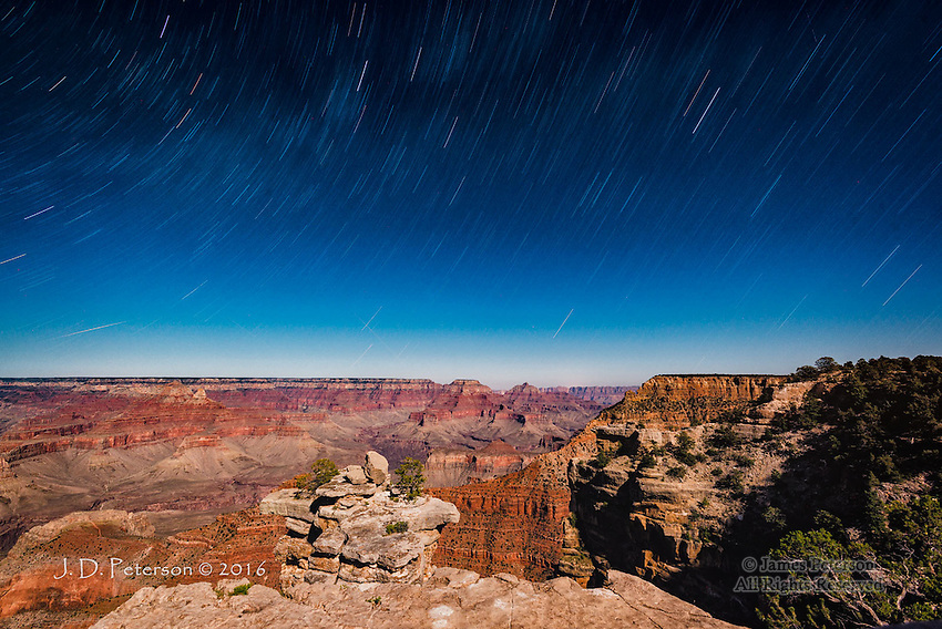 Mather Point by Moonlight, Grand Canyon  © 2016 James D Peterson.  This image was made by the light of a half moon, using a sixteen minute exposure.  IN addition to the star trails, the light, hazy areas in the sky are the Milky Way, which has been smeared by the long exposure.