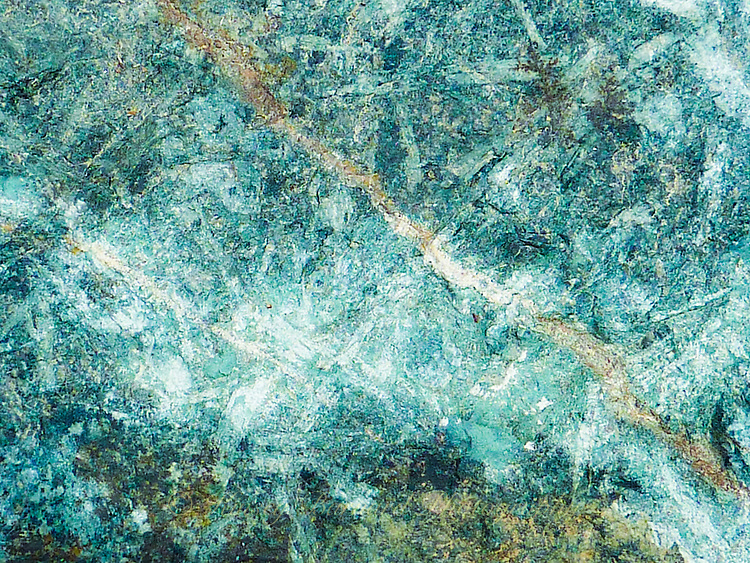 """""""INTERGALACTIC""""<br /> <br /> A blue green galaxy of celestial bodies seemingly lights up the evening sky. But, no that's not it. It's really a macro image of a Montana river rock which creates this intergalactic vision."""