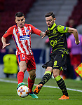 Bruno Fernandes of Sporting CP (R) fights for the ball with Angel Correa of Atletico de Madrid (C) during the UEFA Europa League quarter final leg one match between Atletico Madrid and Sporting CP at Wanda Metropolitano on April 5, 2018 in Madrid, Spain. Photo by Diego Souto / Power Sport Images