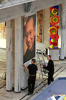 Two workers adjust a picture of Lui Xiaobo before the ceremony. The Norwegian Nobel Committee decided to award.the Nobel Peace Prize for 2010 to Liu Xiaobo. Leader of the Norwegian Nobel Committee Thorbjørn Jagland elaborated on their decision to award the prize to Xiaobo during the ceremony in Oslo Town Hall. .Liu Xiaobo is imprisoned and no immediate family was permitted to leave China to accept the prize. ..Photo: Fredrik Naumann/Felix Features