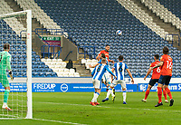 7th November 2020 The John Smiths Stadium, Huddersfield, Yorkshire, England; English Football League Championship Football, Huddersfield Town versus Luton Town; James Collins of Luton Town  wins a header above Jonathan Hogg of Huddersfield Town and Lewis O'Brien of Huddersfield Town