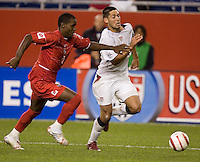 Clint Dempsey of the United States in action against Felipe Baloy of Panama at Foxboro Stadium in Foxboro, Ma, Wednesday Oct. 12 2005. (Photo by Brooks Parkenridge)