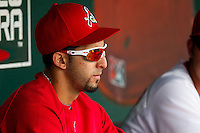 Alex Castellanos (18) of the Springfield Cardinals sits in the dugout during a game against the Arkansas Travelers on May 10, 2011 at Hammons Field in Springfield, Missouri.  Photo By David Welker/Four Seam Images.