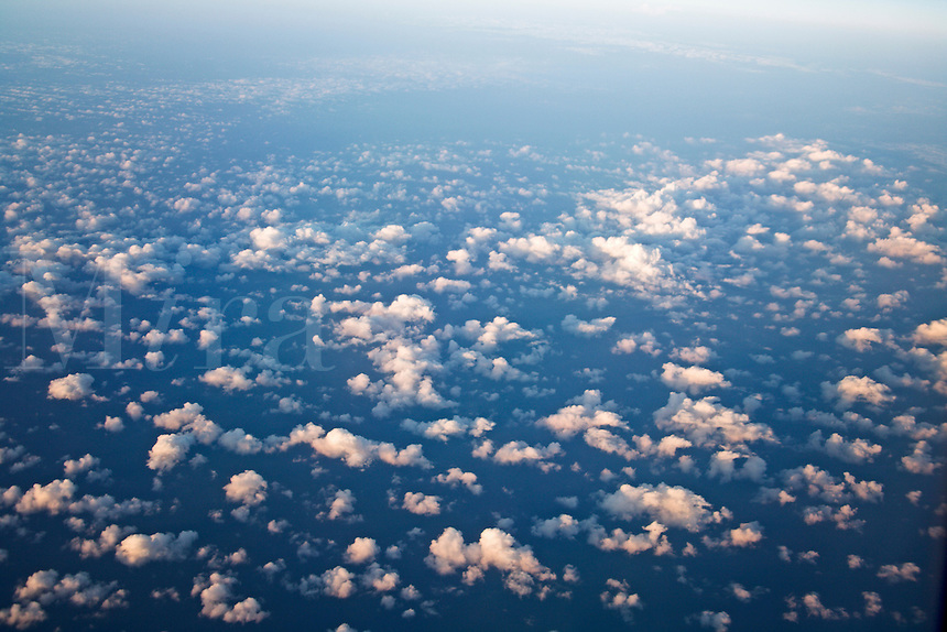 Aerial view of scattered clouds over ocean water