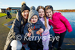 Ava Canty, Hailey and Bobby Powell and Mary Ellen Donovan around the frozen lake in the Tralee Bay Wetlands on Sunday.