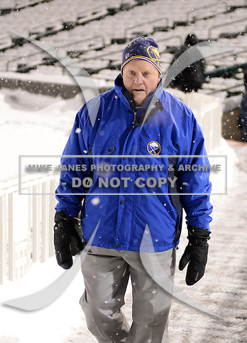 Honorary coach Harry Neale walks to the rink before The Frozen Frontier Buffalo Sabres vs. Rochester Amerks Alumni Game at Frontier Field on December 15, 2013 in Rochester, New York.  (Copyright Mike Janes Photography)