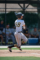 GCL Pirates catcher Manny Bejerano (58) hits a single during a game against the GCL Blue Jays on July 20, 2017 at Bobby Mattick Training Center at Englebert Complex in Dunedin, Florida.  GCL Pirates defeated the GCL Blue Jays 11-6 in eleven innings.  (Mike Janes/Four Seam Images)