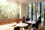 July 12, 2010 - Tokyo, Japan - Staff members of Pasona Group seat at the Cafe of the 'Urban Farm Pasona Group Headquaters' in Tokyo, Japan, on July 12, 2010. Aiming for an amicable working environment with 'Symbiosus with Nature' as a concept, more than 200 types of fruits and vegetables grow in the nine-floor building's verandas.