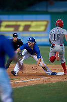 Dunedin Blue Jays first baseman Ryan Noda (19) stretches for a throw as Ben Aklinski (15) runs through the bag during a Florida State League game against the Clearwater Threshers on May 11, 2019 at Jack Russell Memorial Stadium in Clearwater, Florida.  Clearwater defeated Dunedin 9-3.  (Mike Janes/Four Seam Images)