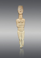 Marble female Cycladic statue figurine with folded arms of the Spedos type. Early Cycladic Period II (2800-3200) from Naxos, Cat No 20934. National Archaeological Museum, Athens.   Grey background.<br /> <br /> <br /> One of the largest known Cycladic statues at 89CM tall this figurine still has traces of a colour on the hair and eyes.