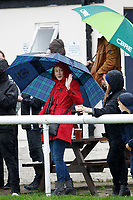 A fan waves at friends during the Greene King IPA Championship match between London Scottish Football Club and Ampthill RUFC at Richmond Athletic Ground, Richmond, United Kingdom on 26 October 2019. Photo by Carlton Myrie.