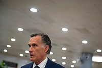 United States Senator Mitt Romney (Republican of Utah) talks with reporters as Senators make their way through the Senate subway during a vote at the US Capitol, in Washington, DC, Wednesday, July 21, 2021. Credit: Rod Lamkey / CNP /MediaPunch