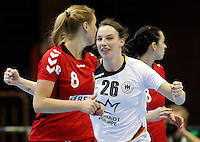Germanyís Angie Geschake (C) celebrate during Women's Handball World Championship 2013 match Czech Republic vs Germany on December 9, 2013 in Novi Sad.   AFP PHOTO / PEDJA MILOSAVLJEVIC
