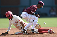 UALR shortstop Eldrige Figueroa (right) misplays the throw from the plate Wednesday, April 7, 2021, as Arkansas short stop Jalen Battles slides in safely at second base during the second inning of the Razorbacks' 10-3 win at Baum-Walker Stadium in Fayetteville. Visit nwaonline.com/210408Daily/ for today's photo gallery. <br /> (NWA Democrat-Gazette/Andy Shupe)