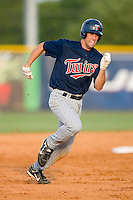 Derek McCallum #7 of the Elizabethton Twins hustles into third base with a triple at Burlington Athletic Park July 19, 2009 in Burlington, North Carolina. (Photo by Brian Westerholt / Four Seam Images)