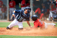 GCL Rays catcher Roberto Alvarez (6) tags out Akil Baddoo (2) during the first game of a doubleheader against the GCL Twins on July 18, 2017 at Charlotte Sports Park in Port Charlotte, Florida.  GCL Twins defeated the GCL Rays 11-5 in a continuation of a game that was suspended on July 17th at CenturyLink Sports Complex in Fort Myers, Florida due to inclement weather.  (Mike Janes/Four Seam Images)