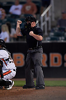 Umpire Joe Belangia calls a strike during a NY-Penn League game between the Vermont Lake Monsters and Aberdeen IronBirds on August 19, 2019 at Leidos Field at Ripken Stadium in Aberdeen, Maryland.  Aberdeen defeated Vermont 6-2.  (Mike Janes/Four Seam Images)