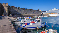 Fine Art landscape Photograph. Colourful Greek fishing boats docked in a port in Rhodes Greece.