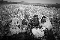 Aymara women cover their faces in Cachilaya near the Titicaca lake in Bolivia, 1998...Photo by Roberto Candia