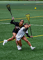 17 April 2021: University of Vermont Catamount Defender Carolyn Carrera, a Junior from Harriman, NY, battles UMBC Retriever Attacker Dymin Gerow, a Freshman from Baltimore, MD, at Virtue Field in Burlington, Vermont. The Lady Cats fell to the Retrievers 11-8 in the America East Women's Lacrosse matchup. Mandatory Credit: Ed Wolfstein Photo *** RAW (NEF) Image File Available ***