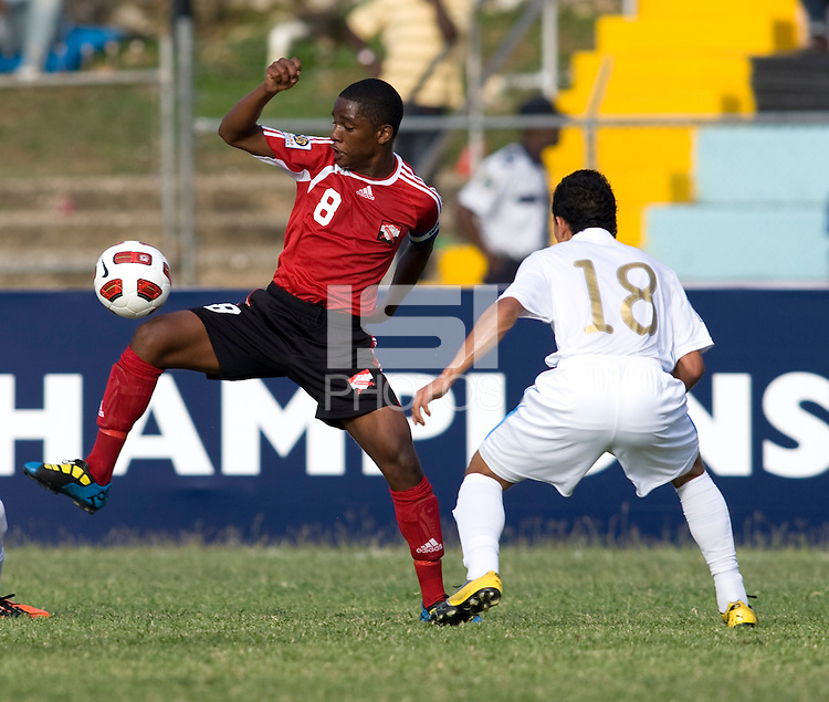Bryan Lemus (18) of Guatemala stays close to Karl Muckette (8) of Trinidad & Tobago  during the group stage of the CONCACAF Men's Under 17 Championship at Jarrett Park in Montego Bay, Jamaica. Trinidad & Tobago defeated Guatemala, 1-0.