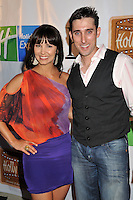 """AMIE BARKSY & PAUL J. ALESSI.5th Annual Hollyshorts Film Festival Screening of """"Knuckle Draggers"""" held at Laemmle's Sunset 5 Theatre, West Hollywood, CA, USA..August 12th, 2009.half length white shirt grey gray waistcoat black red sheer purple top skirt hand on hip.CAP/ADM/BP.©Byron Purvis/AdMedia/Capital Pictures."""