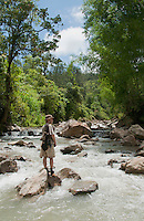 British herpetologist Mark O'Shea stands on a rock in the Meleotigi River, near the village of Eraulo in the Ermera District of Timor-Leste (East Timor). O'Shea is part of an ongoing survey of Timorese reptiles and amphibians.