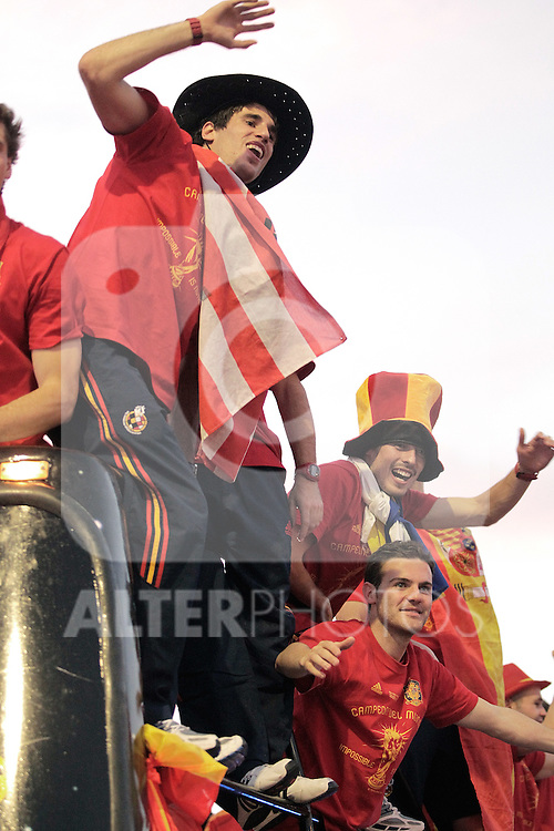 Spain's Javier Martinez, Juan Mata and David Silva celebrate during World Cup championship celebration parade. July 12, 2010. (ALTERPHOTOS/Alvaro Hernandez)