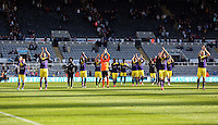 Pictured: Swansea players thank their away supporters after the final whistle. Saturday 19 April 2014<br /> Re: Barclay's Premier League, Newcastle United v Swansea City FC at St James Park, Newcastle, UK.
