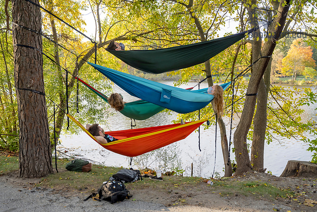 October 9, 2020; Students relax in their hammocks on the shore of St. Mary's Lake.  (Photo by Barbara Johnston/University of Notre Dame)